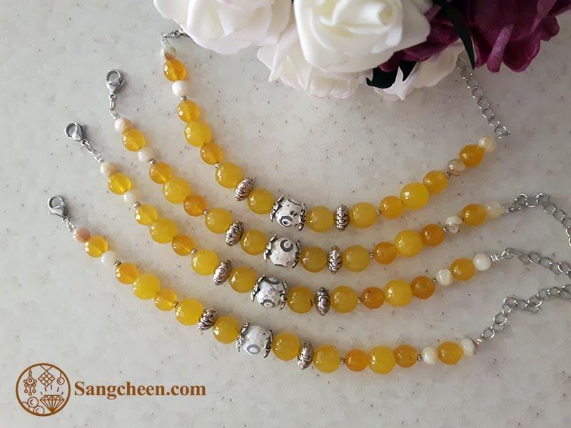 دستبند عقیق زرد با مهره تبتی